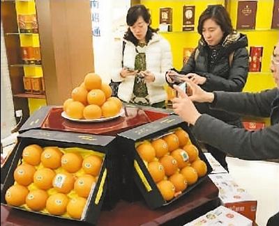 人民日报海外版:秭归脐橙体验馆北京揭牌